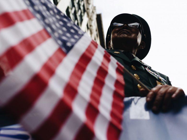 low angle perspective American flag Korean veteran