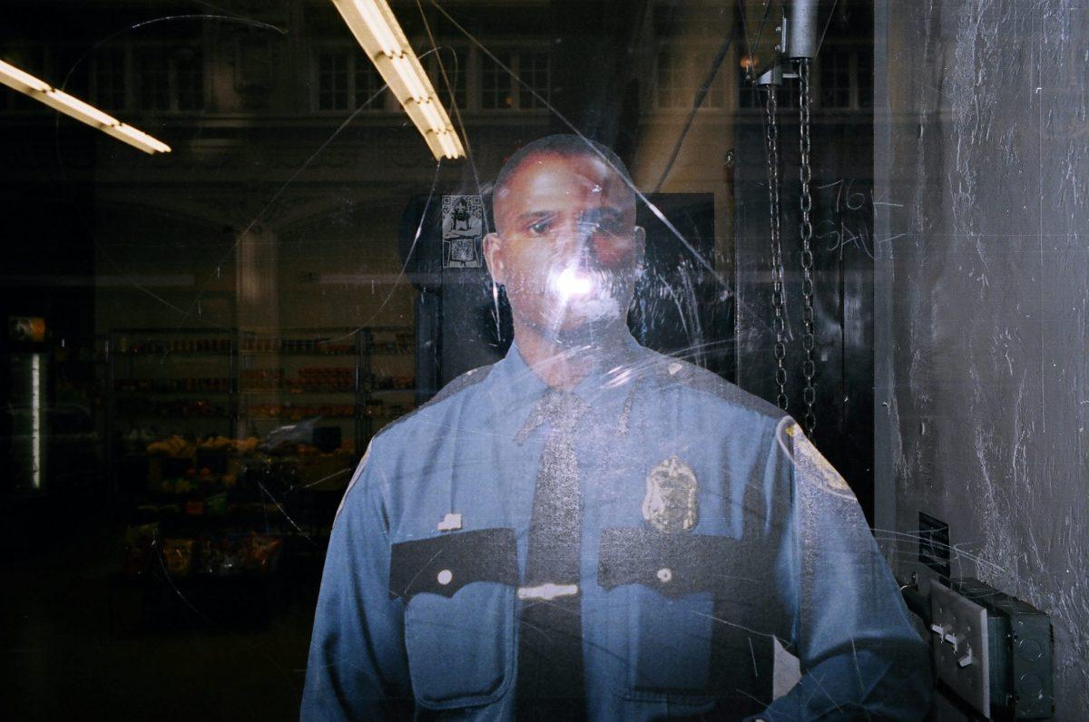 African-american cop cutout. Downtown LA, 2013 #flash #portra400