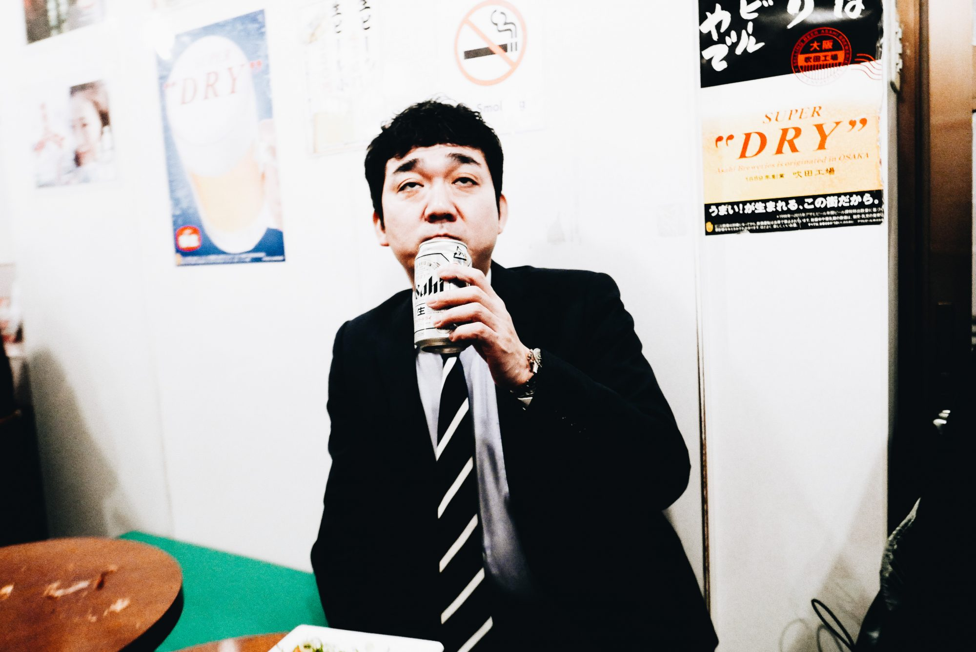 Osaka. Suit drinking a beer