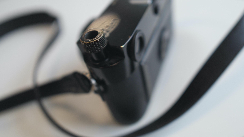 Golden brassing showing in film Leica MP rewind knob