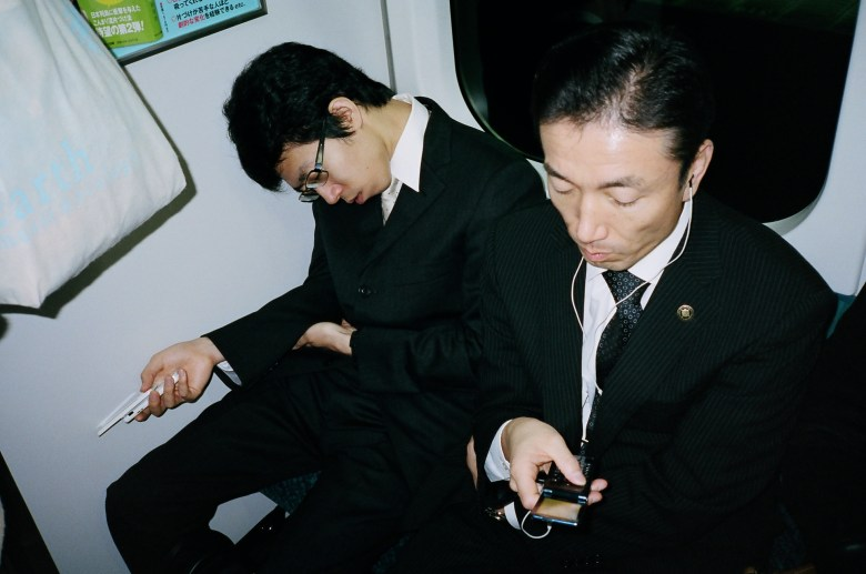 Japan man sleeping on subway train