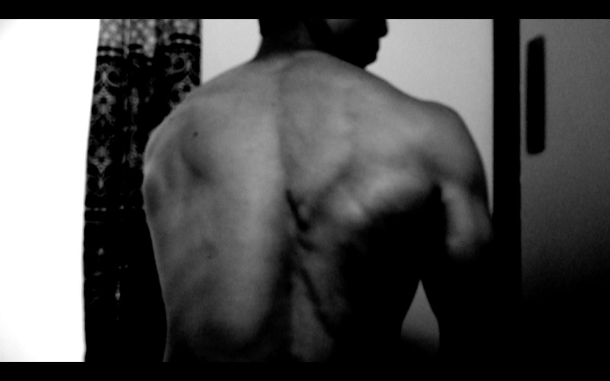 selfie black and white ERIC KIM Back muscle flex