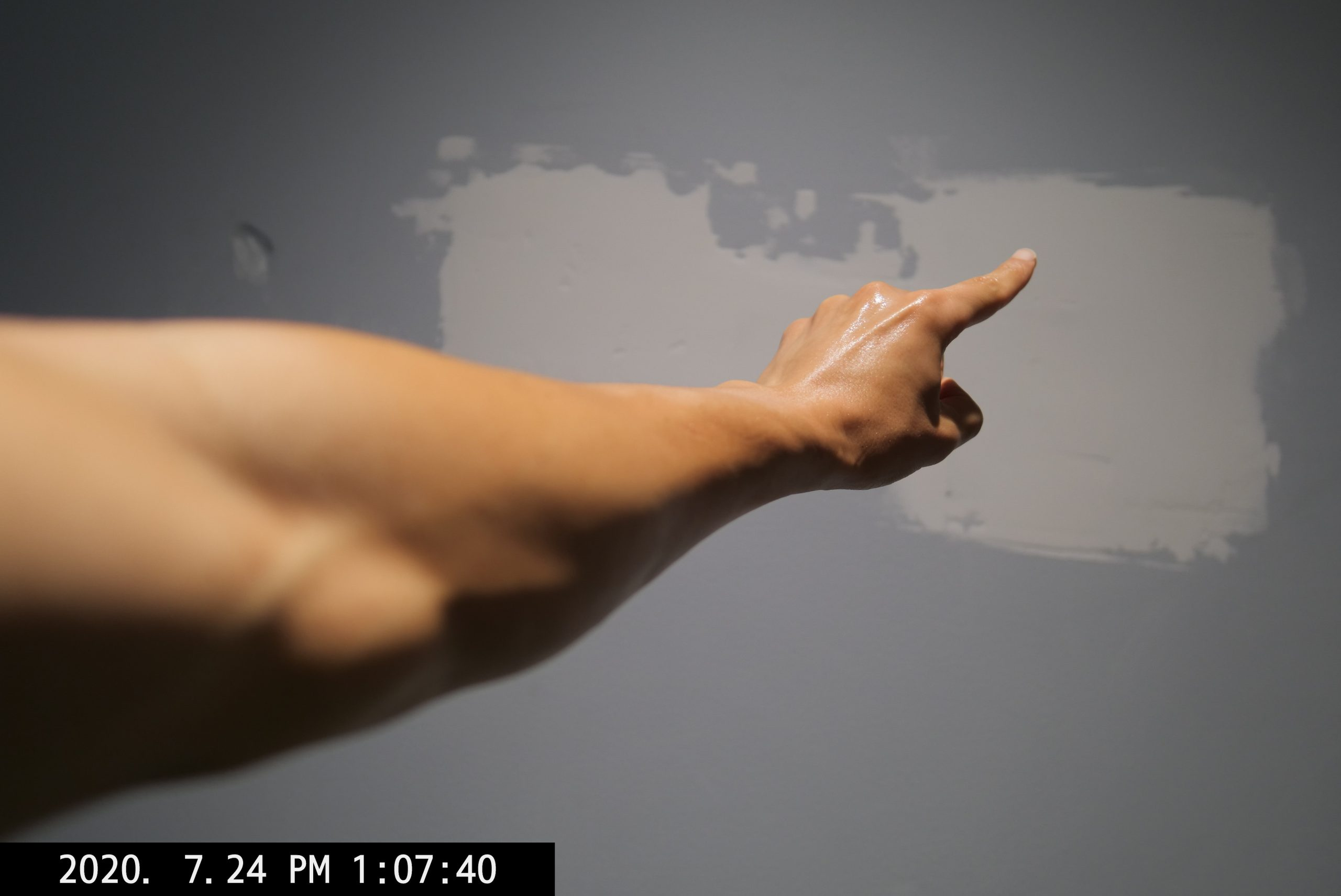 ERIC KIM selfie arm finger pointing