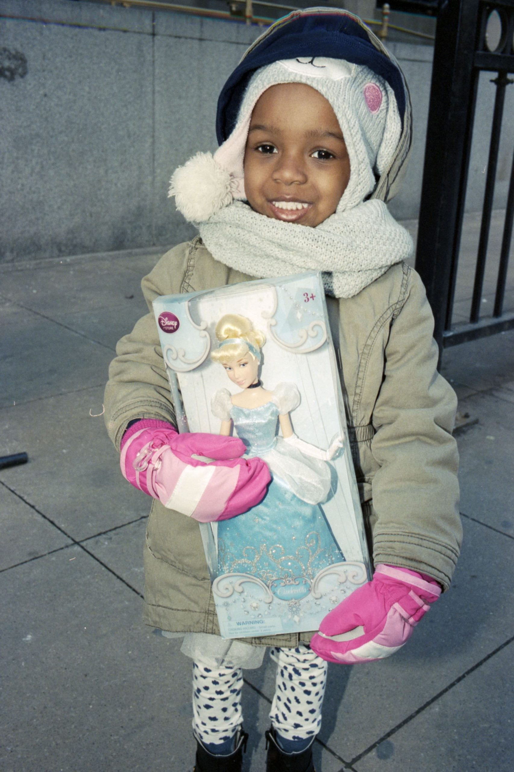 African American girl with caucasian Cinderella doll pink gloves Chicago street photograph ERIC KIM