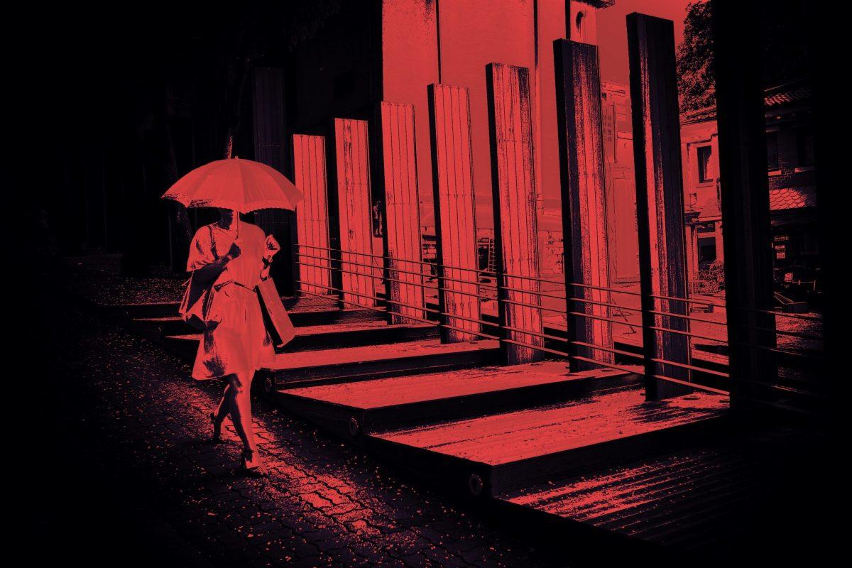 walking woman umbrella crimson red