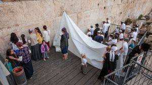 Orthodox Jews pray at the Robinson's Arch section of the Western Wall in a feared attempt to challenge the site's designation as a place for Reform and Conservative prayer