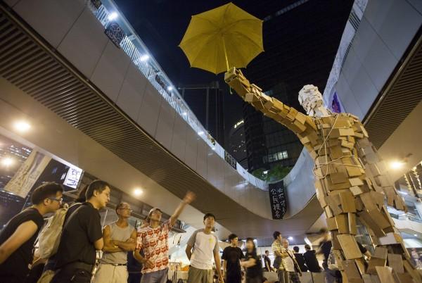Source: http://www.sbs.com.au/news/sites/sbs.com.au.news/files/umbrella_man_141008_aap.jpg