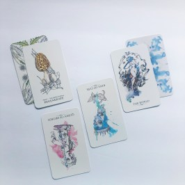 oracle and tarot cards on a white background
