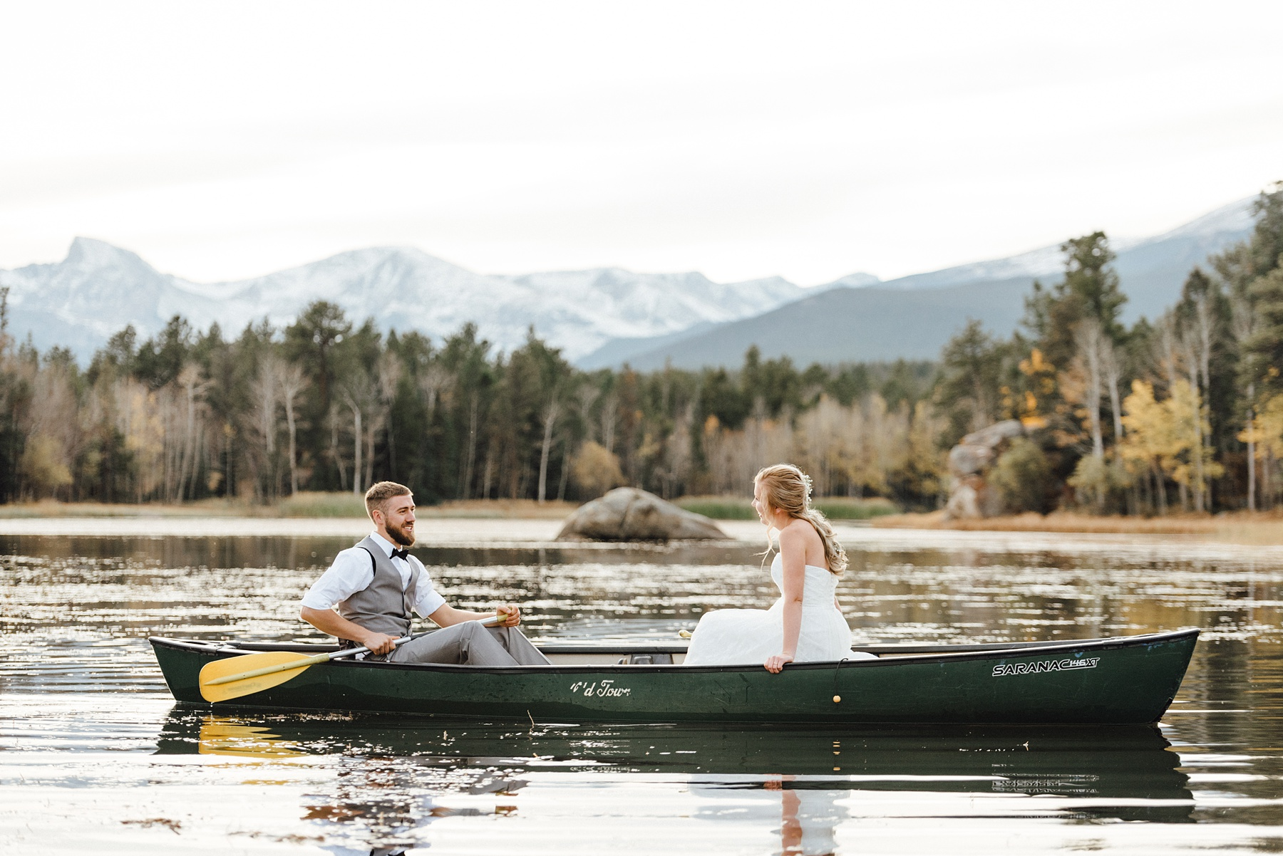 couple canoeing on wedding day, colorado elopement