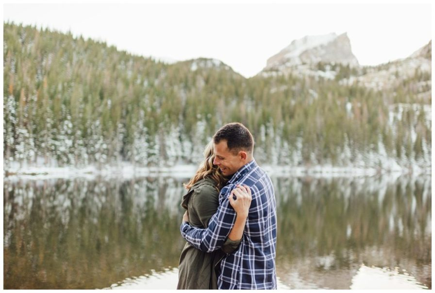 Snowy engagement photos at Bear Lake in Rocky Mountain National Park