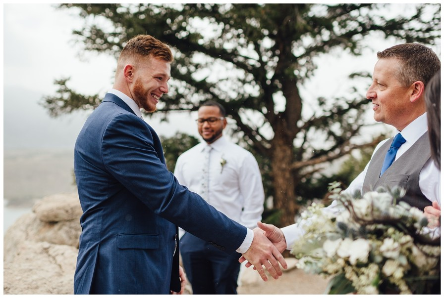 Groom shakes father of bride's hand