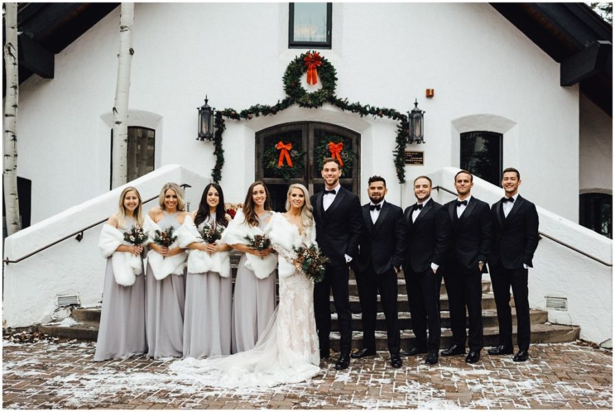 Wedding party for this snowy winter elopement in front of the Vail Interfaith Chapel in Vail Colorado