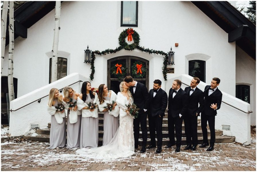 Celebrating with the wedding party on a snowy winter day in Vail Colorado