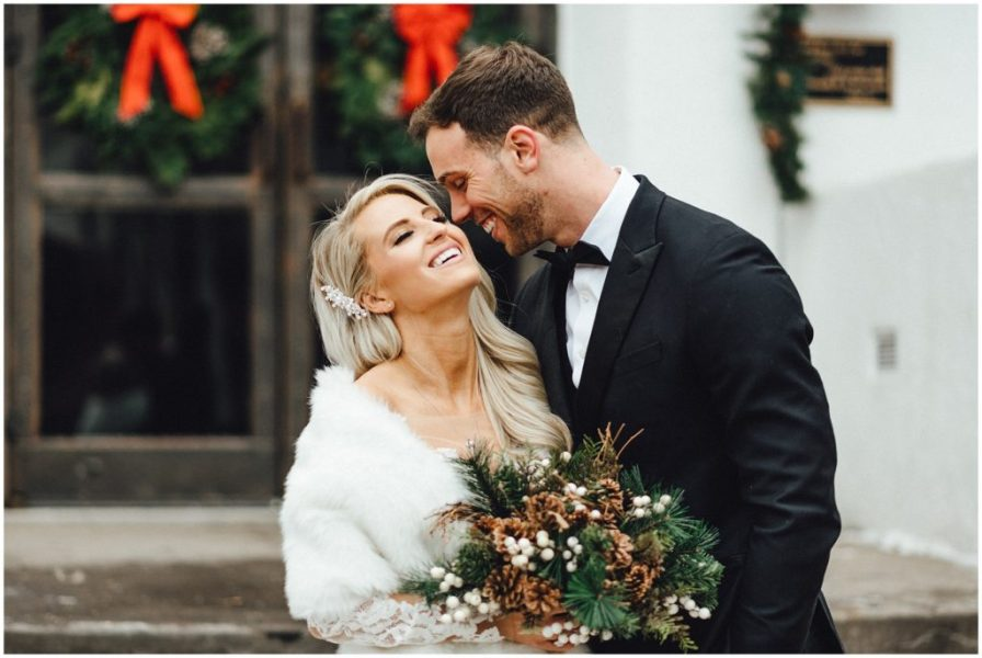 This married couple enjoying a moment after the ceremony at their snowy winter elopement