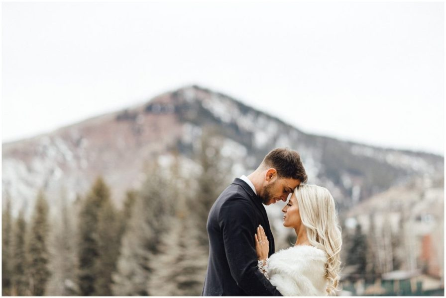 An intimate moment between the bride and groom in Vail Colorado