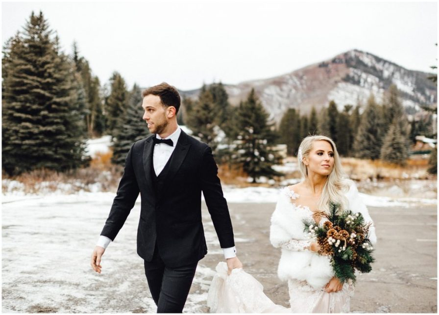 Snowy winter elopement with a beautiful mountain behind the bride and groom