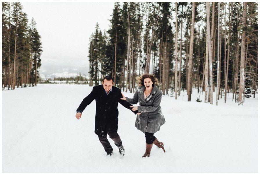 Couple running through the snow