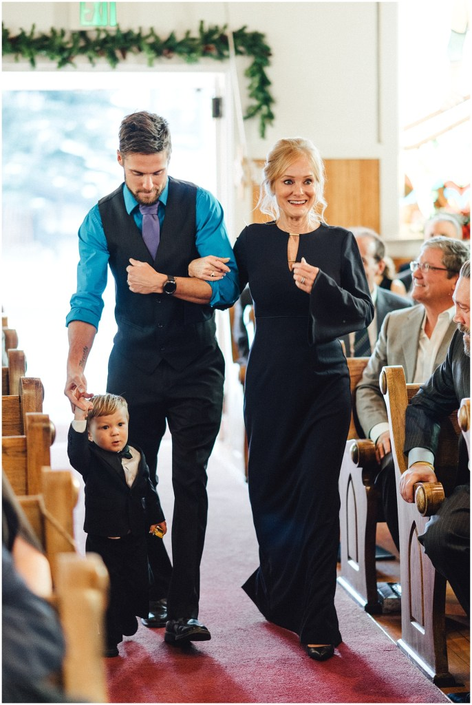 Brides brother walking their mother down the aisle