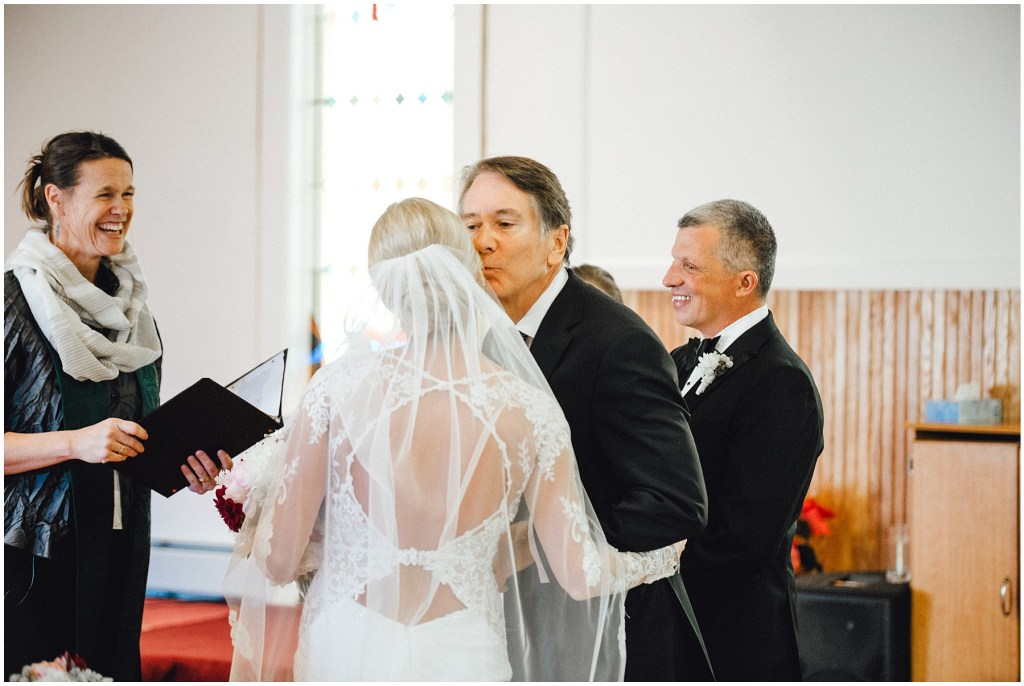 Brides father giving his beautiful daughter away