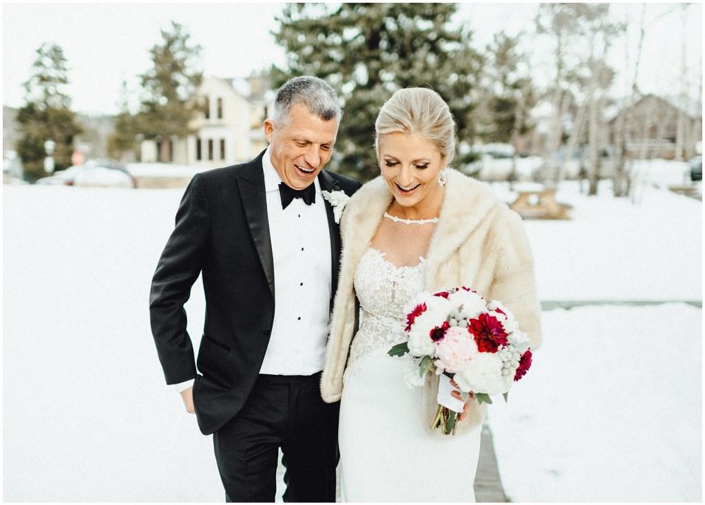 Couple enjoying their amazing Breckenridge winter wedding.