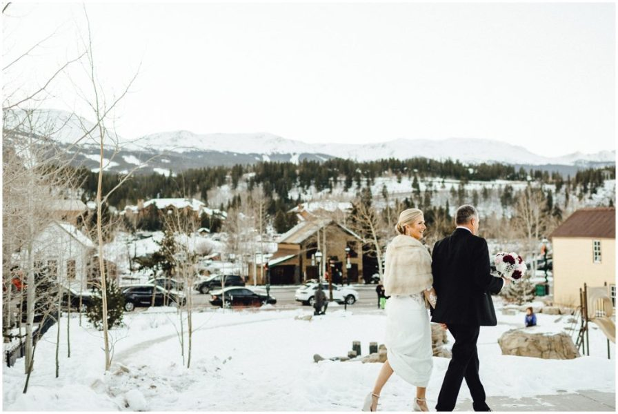 Couple taking a walk after their Breckenridge winter wedding.
