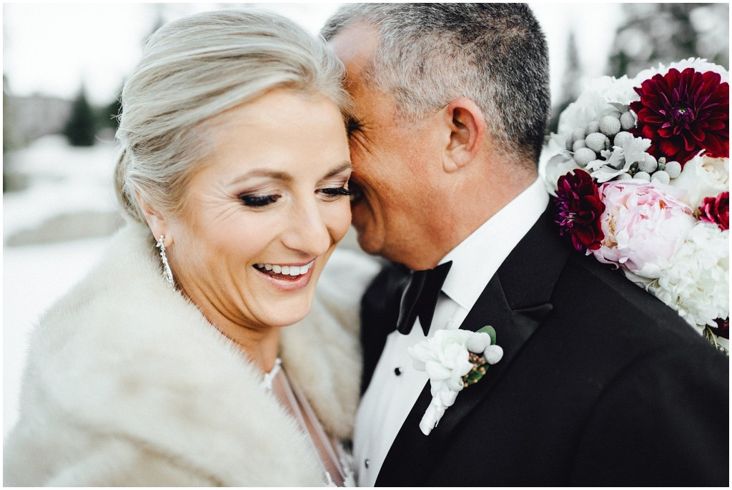 Happy couple at their Breckenridge winter wedding.