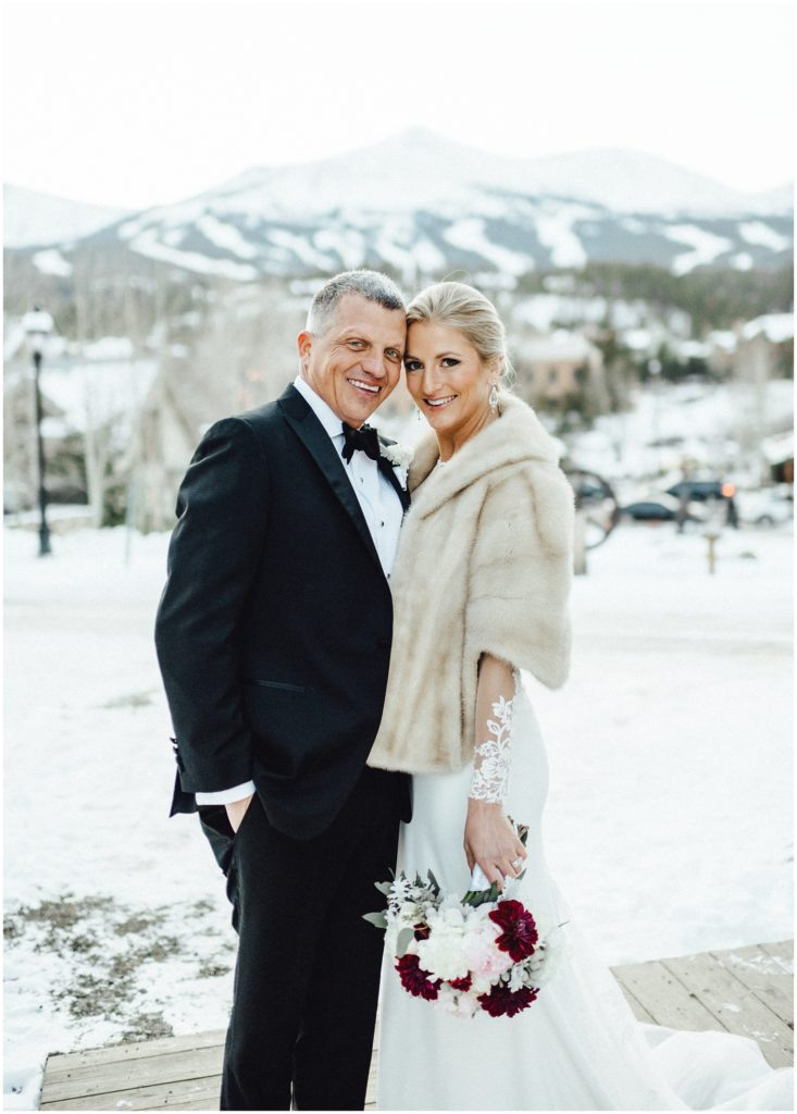 Breckenridge winter wedding in front of those gorgeous Colorado mountains.