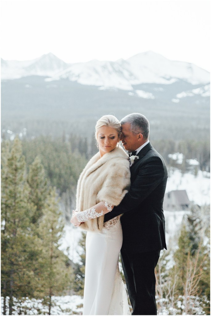 This groom holding on to his beautiful bride at this winter wedding in Breckenridge Colorado.