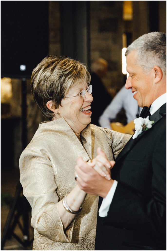 Groom dancing with his mom at his wedding.