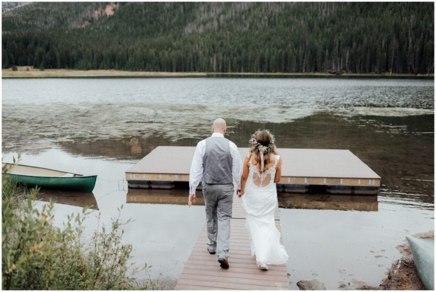 bride and groom walk out on dock