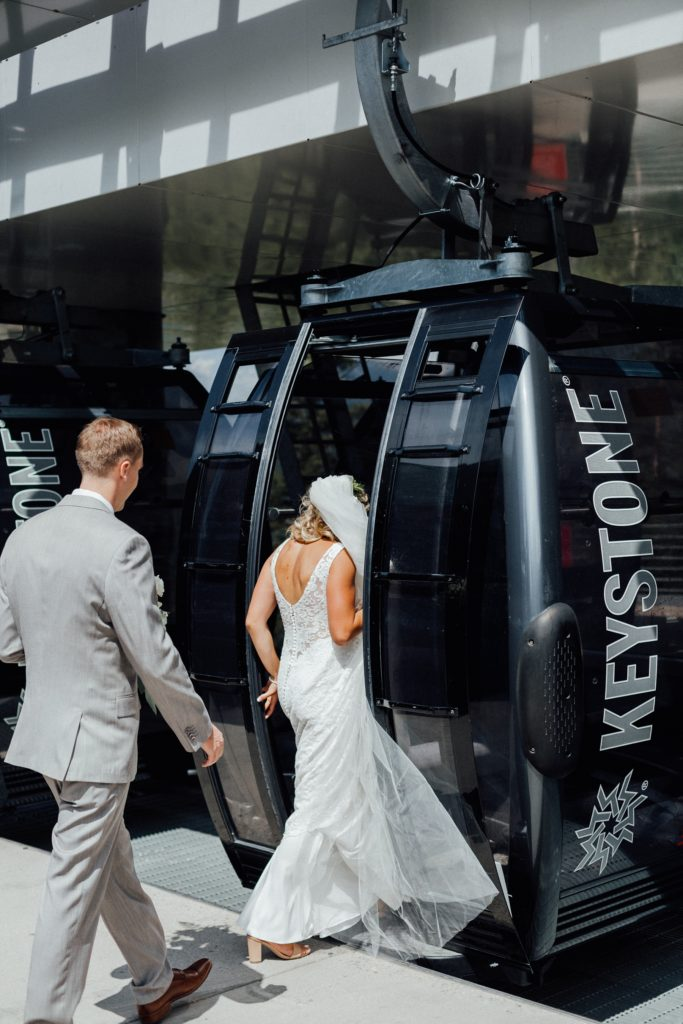 Bride and groom entering ski lift
