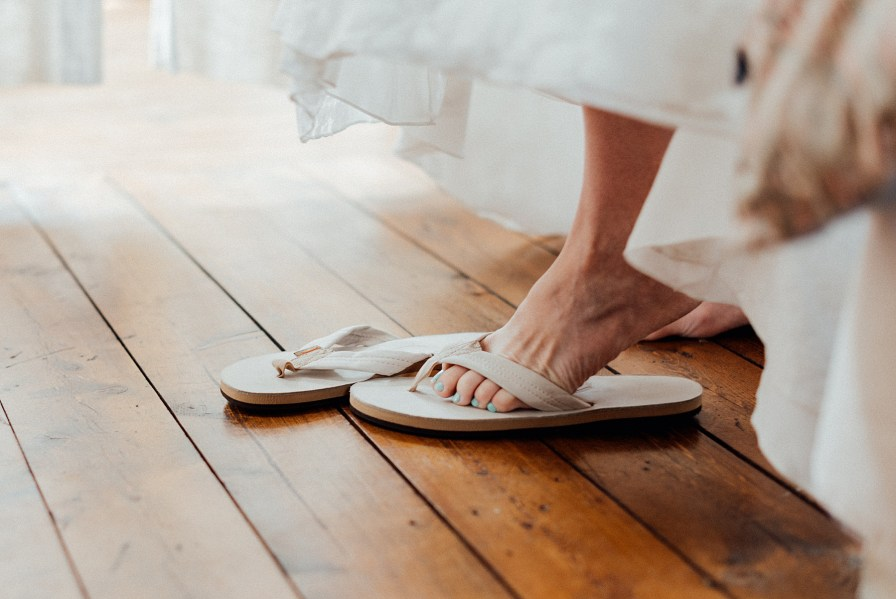 Bride chose to wear flip flops with her wedding dress