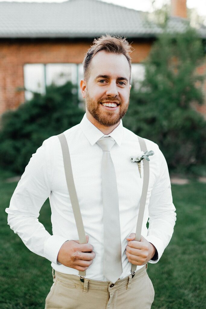 Groom photo ideas, groom outfit ideas, no jacket groom outfit ideas, groom suspenders, white and khaki groom outfit, summer groom outfit, summer wedding male outfit