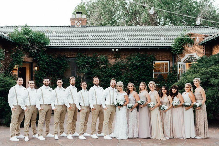 Wedding party photos, wedding party photo ideas, khaki wedding attire, groomsmen suspenders, champagne bridesmaid dresses, blush bridesmaid dresses, gold bridesmaid dresses