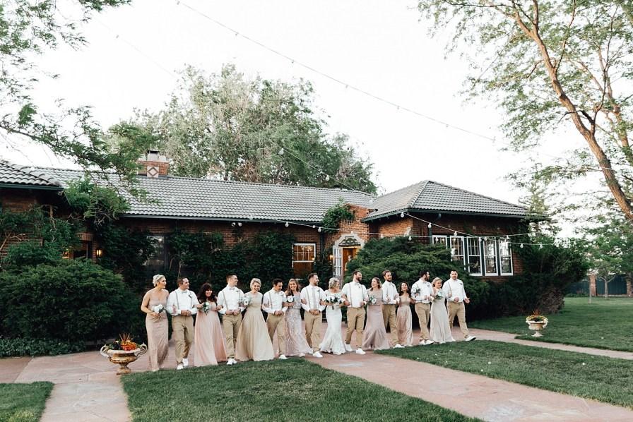 Wedding party photos, wedding party photo ideas, khaki wedding attire, groomsmen suspenders, champagne bridesmaid dresses, blush bridesmaid dresses, gold bridesmaid dresses, bridesmaid and groomsmen photo ideas, bridal party photo ideas