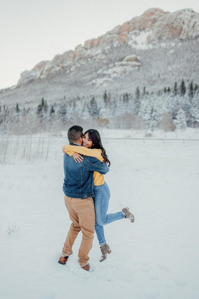 snowy engagement photos in Estes Park, Colorado