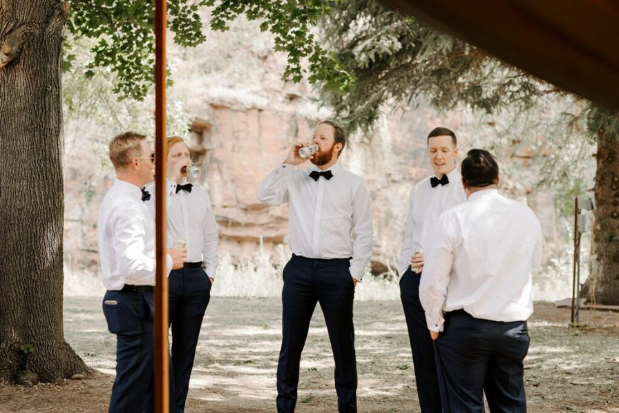 groom and groomsmen enjoying a beer