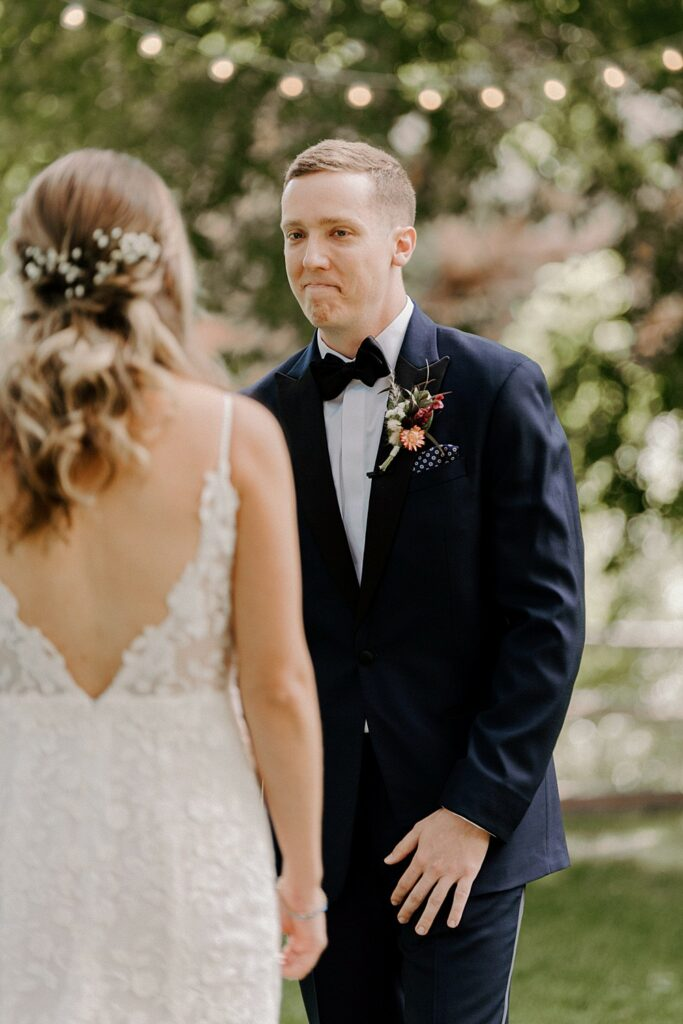 groom sees his bride for the first time on their wedding day at River Bend