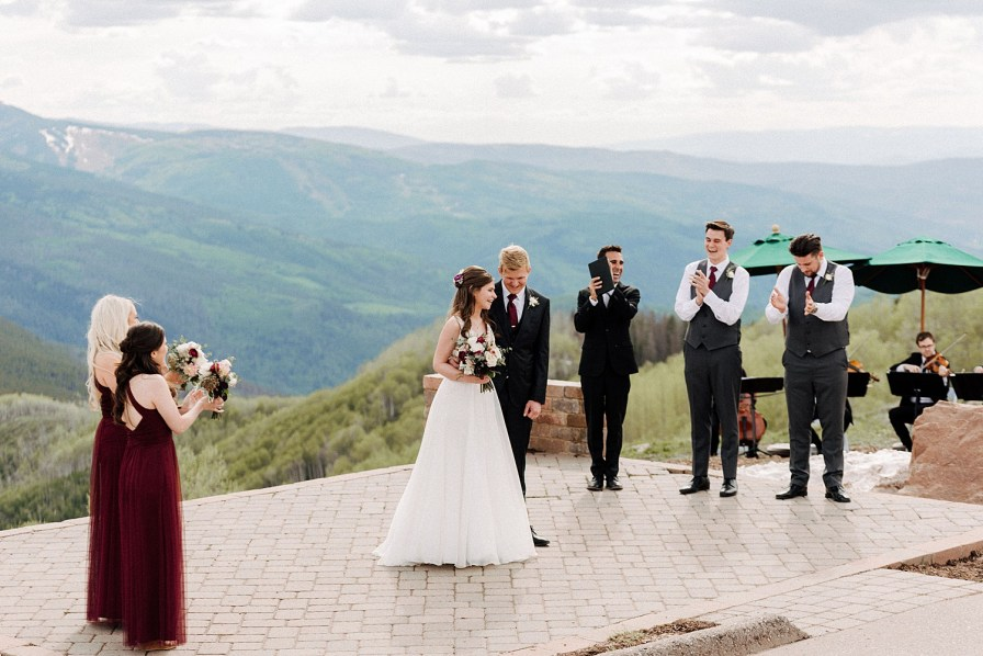 wedding ceremony at the vail mountain wedding deck