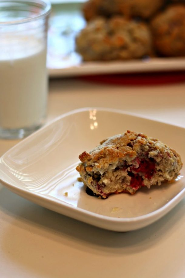 Single Plate of gluten free raspberry and white chocolate scone half eaten | Erika's Gluten-free Kitchen www.erikasglutenfreekitchen.com