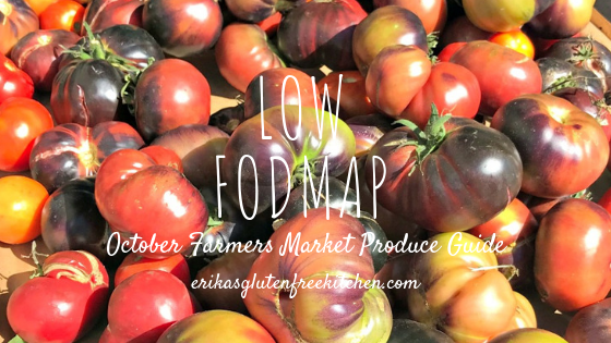 dark tomatoes on a table and text noting this is the october low FODMAP produce guide