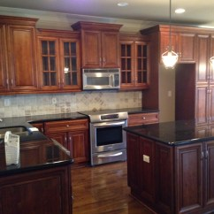 Kitchen Updates Carts Easy You Should Make Right Now Erika Ward The Wood Stained Cabinets Are Traditional In Style And Perfect Condition Black Granite Countertops Added A Modern Edge Which Probably Was