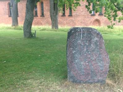 Viking rune stone + christian church