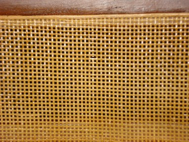 Detail of defect in caning on Risom Side Chair.