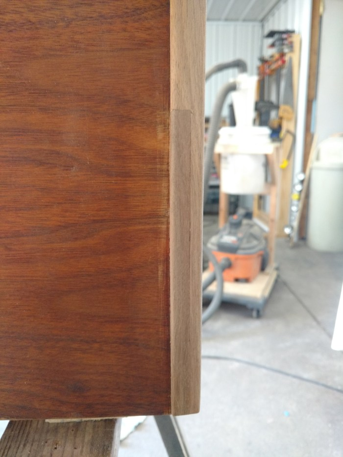 Jens Risom Credenza: New walnut trim cut, secured in place and shaped.
