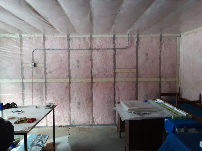 Insulation and vapor barrier hung in new shop space at Erik G. Warner Decorative Salvage, November 2018.