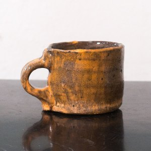 Erik Haugsby Pottery ceramic orange and brown coffee mug handmade made from local clay