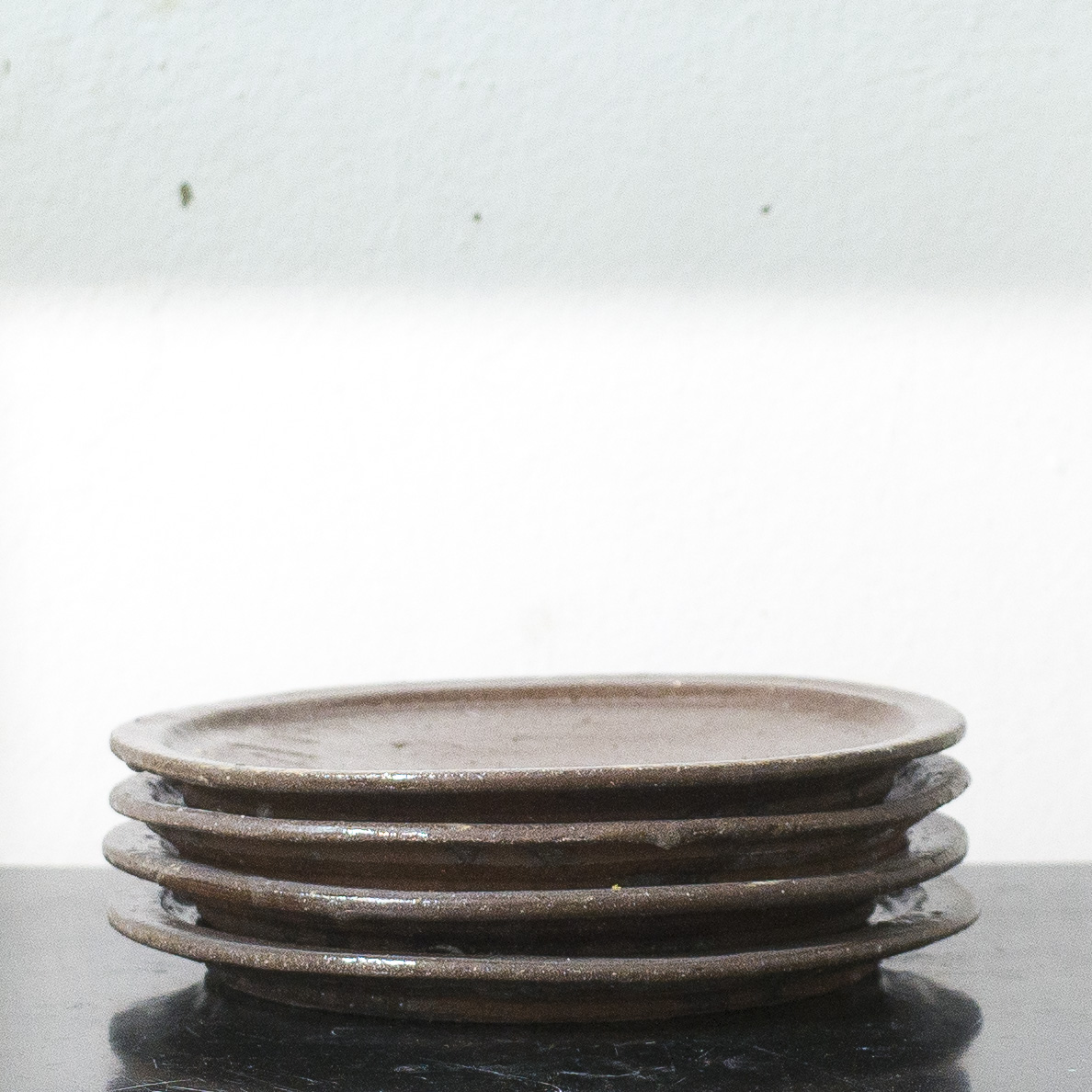 Erik Haugsby Pottery set of four brown plates made from local clay