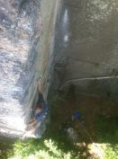 Erik working on the FA of Big Foot Arete at Greens