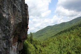 A climber lowering off of Big Red (5.11d) at Wild River crag